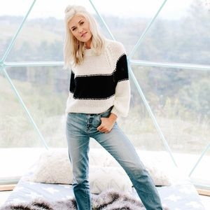 Vestique crashing headlines sweater